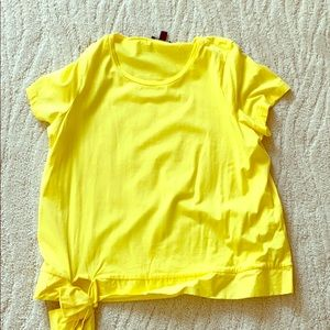 Yellow t shirt blouse with bow on bottom